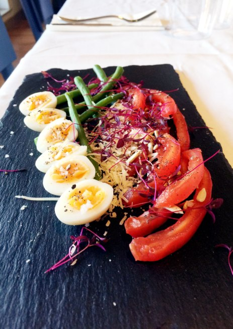Quail eggs with a tomato, green bean and caper salad.